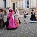 women in costumes with photographer
