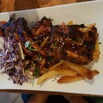 Korean BBQ pork ribs with sesame seeds, pecan nut coleslaw sriracha and handcut chips