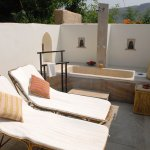 Private open air bath tub and loungers