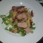 Grilled pork medallions with spaghetti