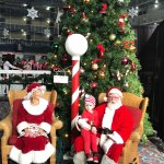 Santa and Mrs. Clauseat The Carousel  during the Christmas Parade