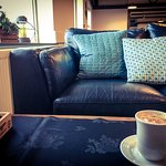 A number of sofas provide comortable seating in which to sit back and relax with a cup of coffee
