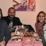 Happy good friends and Apostolis, the owner, ready to eat!