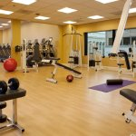Fitness center with cardio, strength training equipment and pool