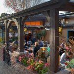 Our famous outdoor patio with heaters and a firepit
