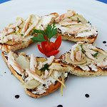 Bruschetta with Artichokes, Goat Cheese, Cream Cheese and Smoked Trout