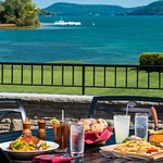 Outdoor dining with views of Lake Otsego