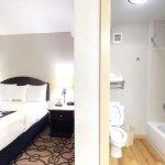 Queen suite bathroom and sleeping area