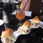 Crab cake sliders with happy hour Mai Tai