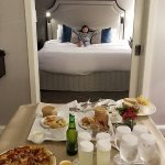 My 7 year old daughter enjoying the room and some room service :)