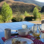 Attempted artsy pic of outdoor morning breakfast with amazing view of mountains!