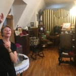 Sonya in the upstairs ballroom, that now houses many antiques from the early 1900's