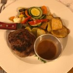 Beef stake with vegetables and pepper sauce
