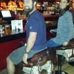 Million Dollar Cowboy Bar - riding the saddles at the bar