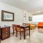 Sala de la Junior Suite — Hotel Dann Combeima (Ibagué, Colombia)