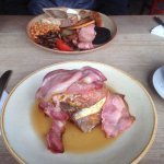 Giant french toast and bacon drenched in maple syrup! (also a full breakfast in the back)