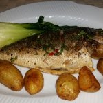 """Baked honey glazed whole Sea Bream"" Served with roasted potatoes and pak choi"