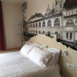 Unique pics over bedhead add interest to room