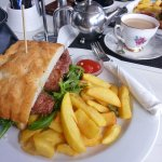 Steak sandwich with chunky fries and tea in a real cup!