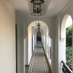 beautiful open walkways to rooms with amazing flooring detail and arches.