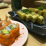 Tamagoyaki and some kind of sushi roll