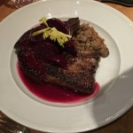 Thick, bone-in pork chop with beets