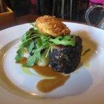 Poached Hens egg over Black Pudding & Salad Greens