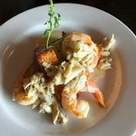 shrimp with cheesy grit cakes and crab