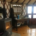 cozy fireplace in each yurt