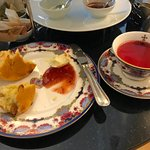 Scone with jam and tea