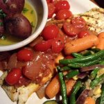 Snapper with Italian sauce, roasted potatoes, and veggies