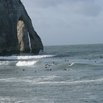 Surfers at Etretat