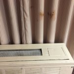 Stained curtains, damaged air conditioner