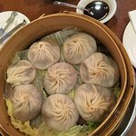 Soup Dumplings (one portion, second one is underneath, there are two layers inside the steam-tow