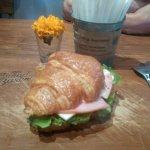 Yummy sandwich, chicken lasagna and capucinno coffee