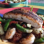Seafood Mixed Grill...grilled mahi mahi, shrimp on a bed of red rice, peppers and onions.