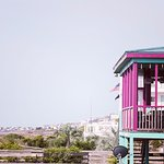 Right on the beach. Great views from our dining deck and our rooftop bar deck.