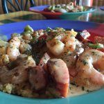 Shrimp n' Grits.  shrimp, sausage, white sauce topped on a bed of pimento cheese grits.
