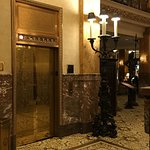Beautifully decorated elevator leading to original rooms
