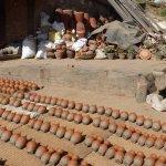 Pots lying on the street drying