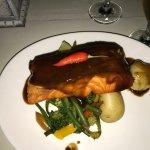 Salmon with bourbon sauce, potatoes and veggies.