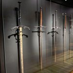 Two-handed ceremonial swords, and a functional one on the right that saw actual combat.