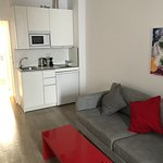 Living room/kitchen area. Uncluttered, clean, comfortable.