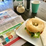 Relax with newspaper and one our New York Bagels.