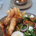 Lightly battered fish and chips, lamb and rossini in the bowl.
