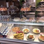 A selection of baked goods, sandwiches and salads