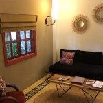 Lounge area on ground floor of room