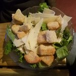Awesome Caesar salad with thinly sliced Parm cheese.