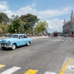 Classic car is crossing Neptuno. Behind classic car is Park Central. Capitol is 2 blocks on righ