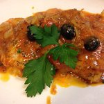 Fresh Cod in fresh tomato,smoked garlic,onions,wine, black olives and parsley sauce....Delizioso
